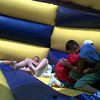 Date:   7/15/97---Despite the heat, (left to right) Lucas Stevens, 15; Aaron Alexander, 16; Johnny Chacon, 15; and Jason Folmar, 19; enjoy goofing around outside in a spacewalk as one of the activities of Vacation Bible School at First Assembly Church of God in Longview Tuesday morning.  Jessica Williamson