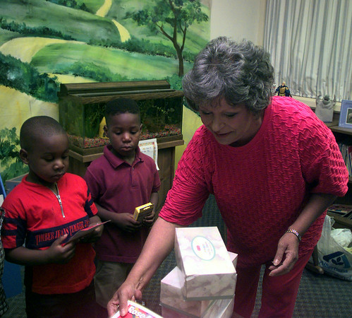Date:   7/21/97---Curtis Jenkins, 4, left, son of Nelmon Jenkins, and Tory White Jr., 4, right, son of Tory White and Lashonda Bowie, receive school supplies from Debbie Bolls, Senior Regent, and other members of the Women of the Moose organization Tuesday morning at Longview Preschool & Childcare Center, Inc.  Jessica Williamson