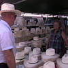 Date:   7/19/97---Melvin Bates, left,  of White Oak, tries on hats with a little help Hazel Brown, owner of Brown Enterprises. The Browns have been in the same spot at Longview Jaycees Trade Days for the past 14 years.  Jessica Williamson