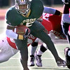 Longview's #15 runs with the ball during the fourth quarter of play against Dallas Skyline Saturday in Ducanville. Kevin Green