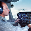 08/5/98---Lauren Bitikofer, director of flight at LeTourneau University pilots one of five of the schools newest Cessna 172 Shyhawks Wednesday afternoon as another is to teh left of him during a flight over Gregg County. Kevin green