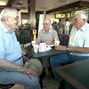 Date:   7/29/98----James Henderson, 83, left, Frank Cobb,83, center, and Bob Bentley,70, right, visit during a morning breakfest at the McDonald's on H80 in Longview. Kevin green