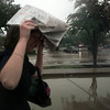Date:   7/15/97---Patrice Fuller, Longview Bank & Trust payroll/benefits administrator, tries to make her way to her car during the rain Tuesday afternnon in Longview.  Jessica Williamson