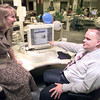 Date:   8/6/98---LNJ interns Sidney Schuhmann, left, and Brandon George, right, discuss a story on the new-journal web site in the newsroom. Kevin green
