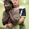 Date:   8/17/98---Danny Benage, volunteer instructor demonstrates a way to prevent choking on Nicole Marshall another volunteer Monday afternoon at teh Red Cross in Longview. Kevin green