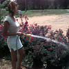 Date:   7/22/97---Sarah Miles, an employee of New Orleans Gardens, waters some crepmyrtles that have leaf scorch, a condition where leaves of the plant brown and die. The extreme temperatures in East Texas are having a damaging effect on plants. Jessica Williamson