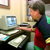 Date:   8/7/98----David Hixson youth pastor at Oakland Heights Baptist Church of Longview takes a look at teh church's website Friday afternoon in Longview. Kevin green