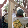 Date:   8/29/98---Ninease Jackson, left, helps brace a wall of her new home during the first work day for the newest Habitat for Humanity home at 435 Main St also will be an all women built home in Longview. Kevin green