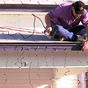 Date:   12/14/98----Mike McDaniel, of Longview, hangs lights at 308 South Green at the Florey House and Law House Monday afternoon in Longview. Kevin Green
