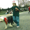 12-6-98 Missy Furrh 10 marching with her dog in the 11th. Annual Liberty City Christmas Parade. Obie LeBlanc.