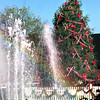 Date:   12/8/98---The sun creates a rainbow in the fountain Tuesday afternoon on the square in downtown Tyler while the tree in the background is decorated for the Christmas holiday. Kevin green