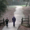 Date:   12/29/98----Tommy Albright, left, and Floyd Faircloth, right, enjoy a morning walk on the Cargill Long Walking Trail Tuesday morning in Longview, as fog hangs close to the ground. Kevin green