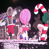 Date:   12/4/98---Amber Boswell,9, left, and Jessica Searcy,9, right, on the Camp Fire of East Texas float wave to the crowd during Friday night's Christmas parade in downtown Longview. Kevin green