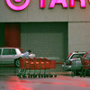 Date:   12/11/98---Target cart attendent Chris Stow braves the cold and wet weather to gather carts Friday afternoon at Target in Longview. Kevin green