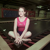 12/17/98---Lyndsay Blundall sits on the corner of a trampoline at East Texas Acro Sports, where she has done a bulk of her training. bahram mark sobhani