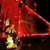 12/09/98---Jim Uhler sits on the back end of a decorated caboose in front of his home on Texas 322. bahram mark sobhani