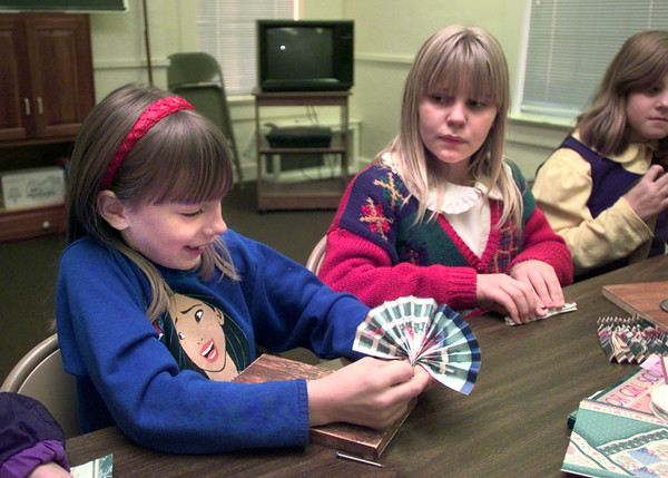 Date:   12/14/98---Girl Scouts Caroline Morton, 8, left, and Chantelle McCommack,9, right, make paper fans for ornaments for donated Christmas trees Monday afternoon at Our Redeemer Lutheran Church in Longview. Kevin green