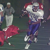 12/12/98---Paul Pewitt's Ben Johnson breaks free for a score in the second half against Brookshire Royal Saturday in Bedford. bahram mark sobhani