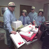 12/21/98---Bemis Custom Products employees Cody Jones, Jerri Brown, Bill DeBaca and Claudette Weaver, from left, unload bags of gifts donated to the Truman Smith Children's Care Center in Gladewater. The gifts will be given to the children on Christmas morning. bahram mark sobhani