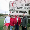 12/09/98---Members of Trinity United Methodist Church in Longview stand by the marquee promoting their 80 miles to Bethlehem walk. From left are Jimmy and Dianne McGrede, Walt Dillard and Pastor William Sterling. bahram mark sobhani
