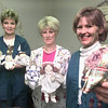 Date:   12/16/98---GSMC outpatient Chemotherapy dept. nurses Lisa Mitchell RN, left, Dodie Bourdon RN, center, and Jeanie Thrower RN OCN, right, hold angels they have decorated with and some of the patients have made and given to them. Kevin green