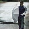 Date:   12/10/98---Eddie Johnson uses his umbrella to shield the wind as he makes a long, cold walk down Humble Street in Longview to his aunt's house. bahram mark sobhani
