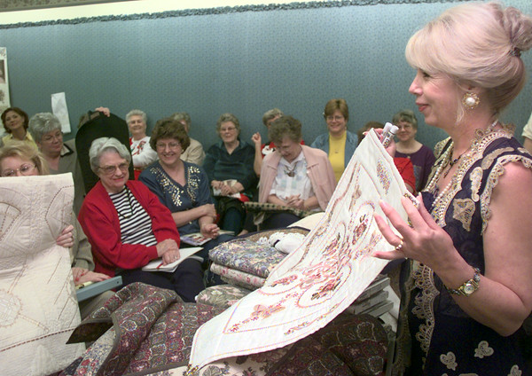 Date:   12/1/98----Fabric artist Jonny Haskins, right, shows off some of her sewingwhile speaking to a group Tuesday morning at Sharman's Sewing Center in Longview. Kevin green