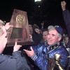 12/12/98---Paul Pewitt head coach Ronald Bickham accepts the UIL State Championship trophy after the Brahmas defeated Brookshire Royal Saturday night in Bedford. bahram mark sobhani