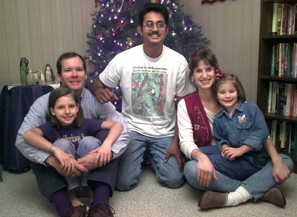 Date:   12/16/98--Lef to Right Front to back----Jackie,9, and her sister Laura,7, dad Drew Student David Chatterpaul, center and Jennie Coleman, at the Coleman's residence. Kevin green