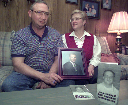 12/22/98---Decell and Lynell Shamburger hold a college picture of their son Ron, while sitting in their living room. In the forground are copies of Ron's testimony, which he wrote after going to death row for capital murder. bahram mark sobhani