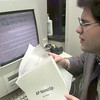 Date:   12/11/98---Michael Saikin, editorials editor of the Long-View, holds the AP Newsclip user guide as he reads stories Friday afternoon at LHS in Longview. Kevin green
