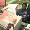 12/21/98---Arah Trimble of Kilgore buys a set of gift certificates Monday at Longview Mall. Trimble said that when shopping for teenagers, gift certificates are the safest bet. bahram mark sobhani