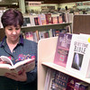 Date:   12/29/98---Linda Rosenau takes a look at one of the many daily Bibles offered by New Life Bible Book Store in Longview. Kevin green