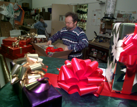 12/22/98---Norce Lankford boxes up a gift for sending at Total Packaging in Longview Tuesday.