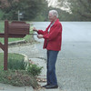 Date:   12/9/98---Trinity United Methodist Church member Walt Dillard places an information card inside a mailbox during a walk. Members of the church are walking 80 miles Ñ the distance from Nazareth to Bethlehem Ñ to promote the church and pray for people in the community. bahram mark sobhani
