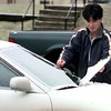12/23/98---Jimmy Nahm of Longview uses his key to pry away ice from the windshield of his car Wednesday. Nahm said he did not expect to see his car covered with such thick ice. bahram mark sobhani