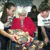 Date:   12/15/98---Union Grove High School varisty cheerleaders Shannon Hiltz, left, and Lynn Turner, right, pass out gifts with other cheerleaders to Sunrise Care and rehabilitation center resident Lorene Hewitt, center, and other residents Tuesday afternoon  in Gladewater. Kevin green