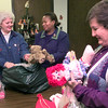 Date:   12/15/98----Left to right--- Kathy Albright, left, with doll club, city lady Unell Bisor, center, and Sharron Foster, right, unpack items they doneated for needy children to have present. Kevin green
