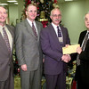 Date:   12/14/98---Lef to Right---David Wilson, vp, Rogers Pope, chairman of the board, Scott Dickerson, senior VP, present check to Les Galloway, Monday morning at LB&T in Longview. Kevin green