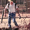 Date:   12/28/98---Keith Weaver of Keith's Lawn and Landscaping of Longview, cleans up a yard on Fouth Street in Longview Monday afternoon by blowing the leaves in a pile. Kevin green