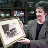 Date:   12/29/98---Dr. Van burkleo holds a photo of her grandad who also was a doctor. Kevin green