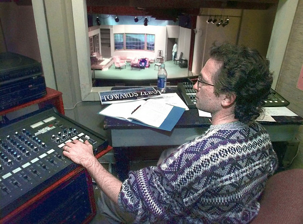 "Lighting technician Steve Crowell works the board as cast members for ""Towards Zero"" rehearse at the Longview CXomuunity Center theater Tuesday night. Matula photo."