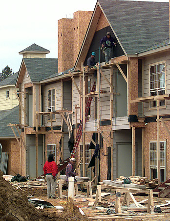 Workers continue construction on an apartment complex on Bill Owens Parkway near H. G. Parkway Thursday afternoon in Longview. Kevin green
