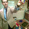 Dr. John Petty holds one of his medals from his trip to Venezuela, Tuesday afternoon at his office in LOngview. Kevin green