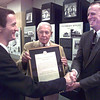 Allen Roberts, left, the president of the Northeast Chapter of the American Institute of Architects, presents the original 1957 chapter charter to teh Gregg County Historical Museum, represented by E. Davis Wilcox, FAIA, center and Gerald Bratz, right, Thursday afternoon in Longview. Kevin green