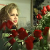 Kim Oden arranges a rose bouquet on what one employee called the busiest day of the year for Longview Flower Shop Friday. With Valentine's Day falling on a weekend, most romantics are getting their shopping done a day early, but most florists will be open Saturday.