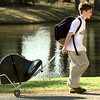 Nicholas White, 12, a sixth-grader at Pine Tree Middle School, rolls his french horn home after school Friday afternoon in the 2100 blk of Buccaneer in Longview. Darlene