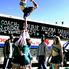 Lobos cheerleader Chelsey Bailey, in the air, showes us how its done at the send off Friday morning for the Lobos girls basketball team departing for Waco. Obie LeBlanc.