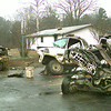 Firefighters from Longview and White Oak llok over the damage of a three vehicle accident killing one and sending two more  to the hospital early Monday morning at H 42 at Harrison Rd. outside of Longview. Kevin green`