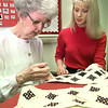 Electa Whipple, left, quilting while Kristie Watkins, right, an occupational therapist, looks on Friday afternoon at the Easter Seals office in lOngview. Kevin green